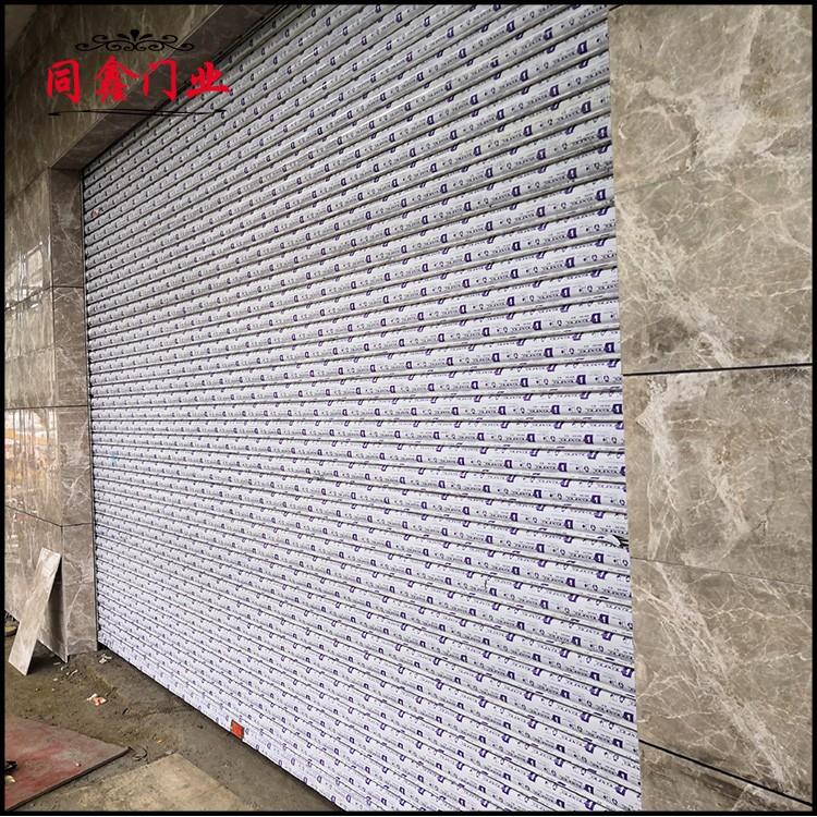 惠州生产安装工业提升门 电动水晶门卷闸门定制供应商